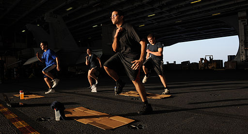 US_Navy_111026-N-OY799-235_Sailors_workout_in_hangar_bay_three_aboard_the_Nimitz-class_aircraft_carrier_USS_John_C._Stennis_(CVN_74)